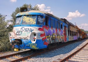 Photograph of railroad car and graffiti