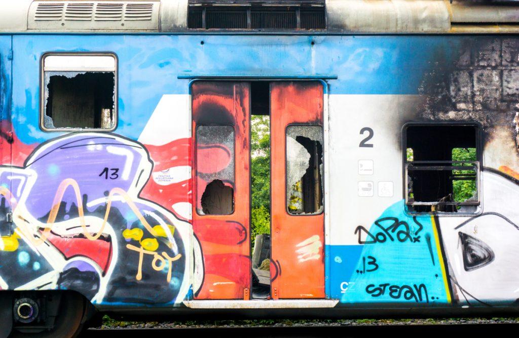 Photograph of railroad car and graffiti