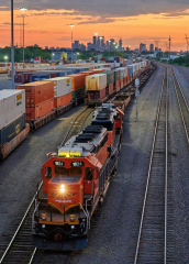 photograph of a freight train at night
